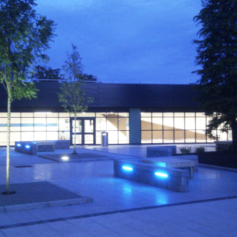 Feature lighting highlights the reflections of smooth paving in contrast to adjacent textured paving