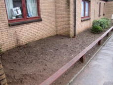 BEFORE: Typical neglected frontage shrub bed