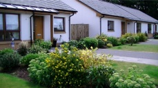 New landscape to front gardens included a mix of shrubs and herbaceous to create a colourful cottage garden with a selection of feature trees, conifers and shrubs in the front lawns.